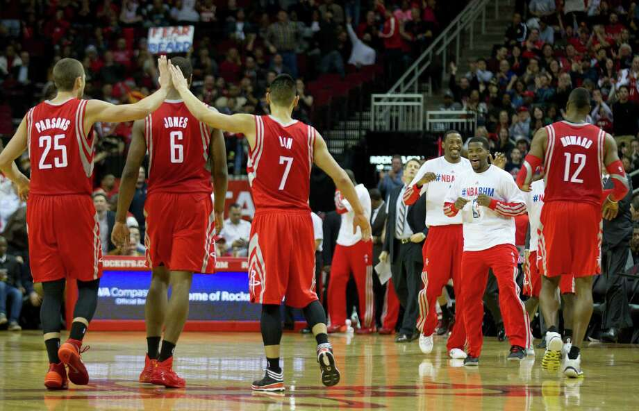 Terrence Jones receives a double dose of kudos from teammates Chandler Parsons, left, and Jeremy Lin during the Rockets' 50th game of the season, a Wednesday win over the Suns that improved their record to 33-17. Photo: Brett Coomer, Staff / © 2014 Houston Chronicle