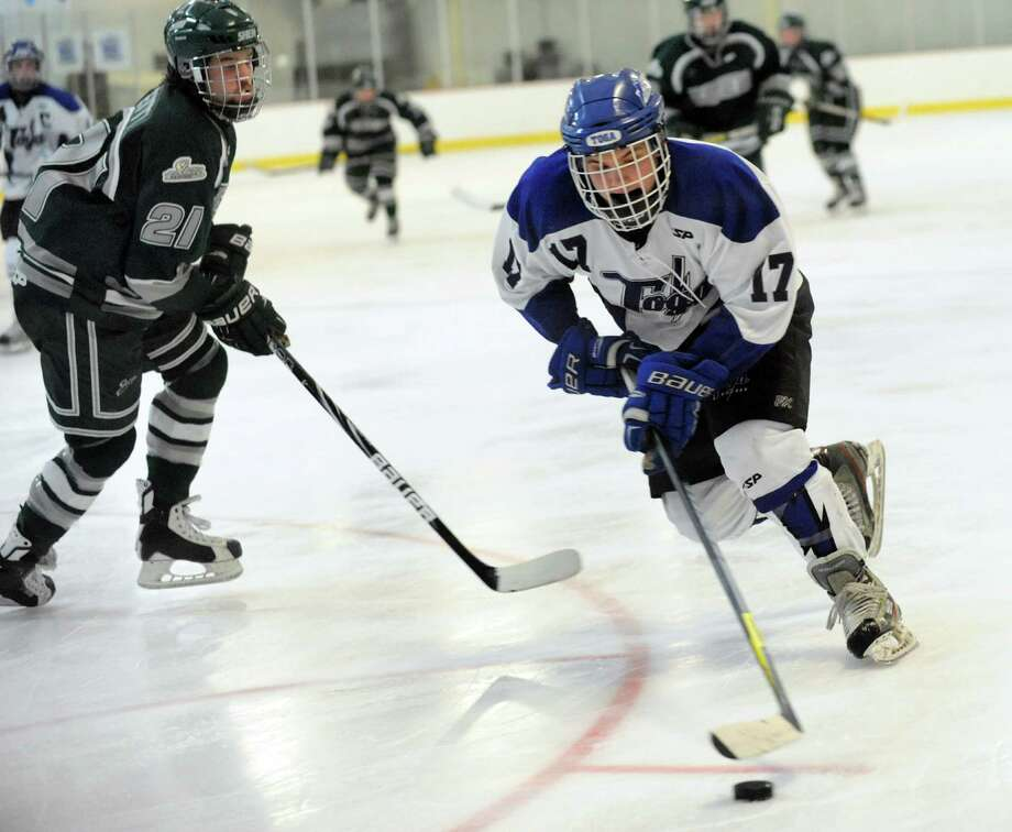 Saratoga's Grayson Rieder, right, guides the puck past Shenendehowa's Tanner Cretti during their hockey game on Thursday, Feb. 6, 2014, at Saratoga Ice Rink in Saratoga Springs, N.Y. (Cindy Schultz / Times Union) Photo: Cindy Schultz / 00025653A