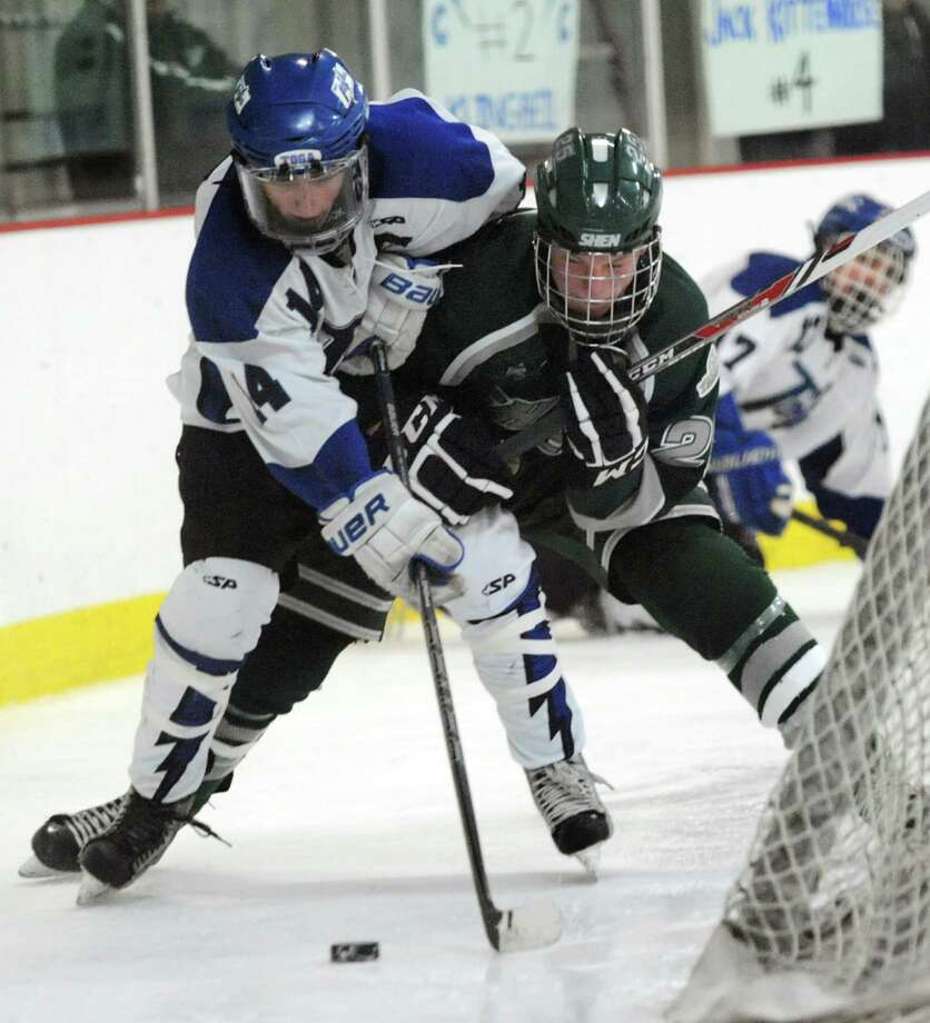 Saratoga's Drew Patterson, left, and Shenendehowa's Cameron Kuhl battle for a loose puck behind the net during their hockey game on Thursday, Feb. 6, 2014, at Saratoga Ice Rink in Saratoga Springs, N.Y. (Cindy Schultz / Times Union) Photo: Cindy Schultz / 00025653A
