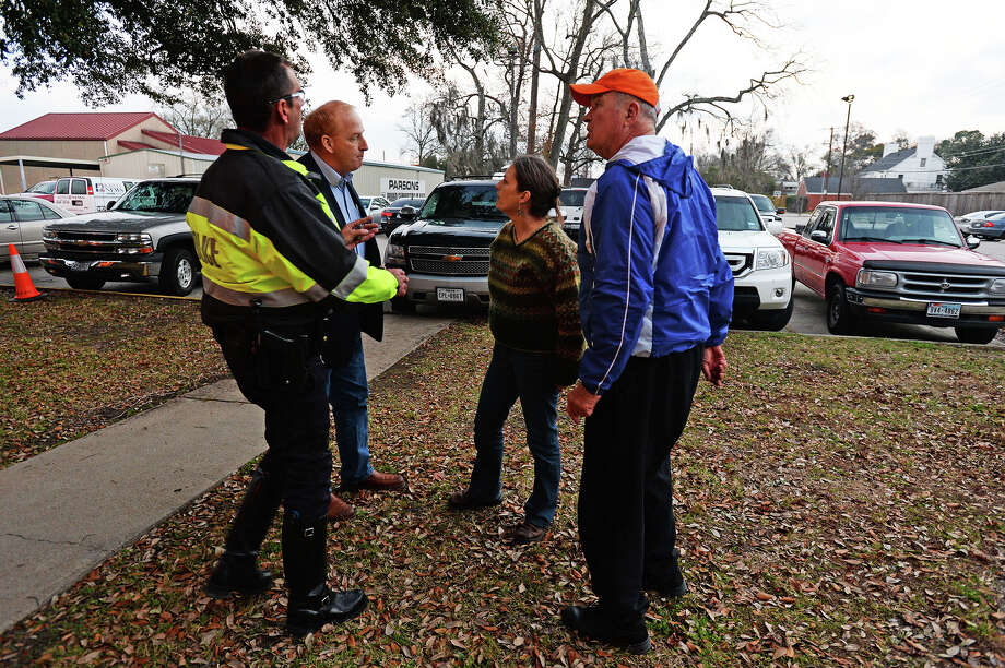 BISD board trustee Mike Neil stands alongside a BISD police officer and Paula and Jimmy Herrington after the pair confronted Neil outside administration building Thursday night. Michael Rivera/@michaelrivera88