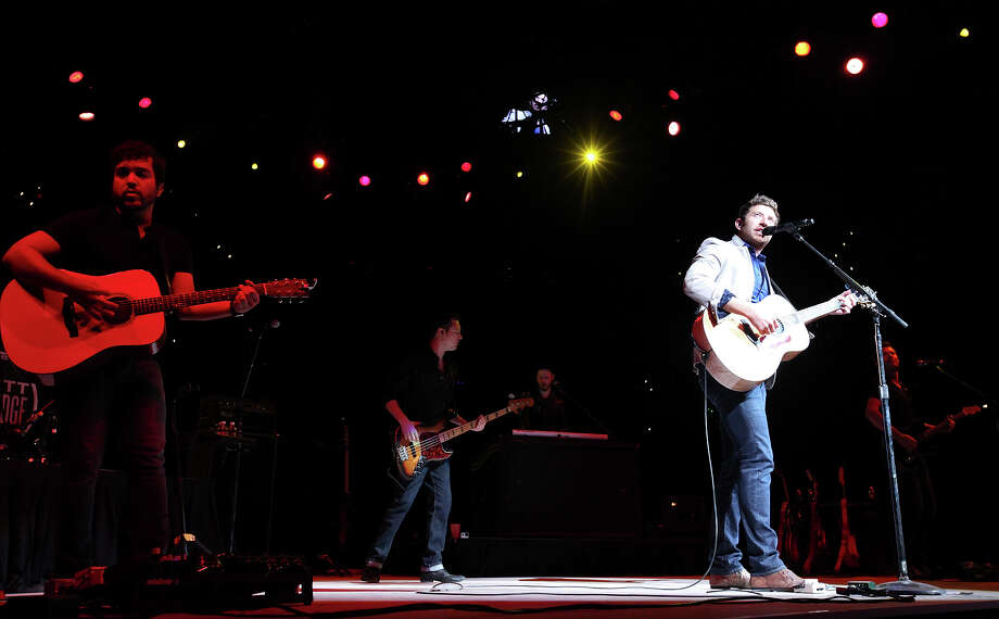 Brett Eldredge (right) performs during the San Antonio Stock Show & Rodeo Thursday Feb. 6, 2014 at the AT&T Center. Photo: Edward A. Ornelas, San Antonio Express-News / © 2014 San Antonio Express-News