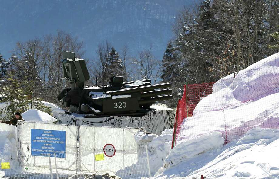 While an anti-aircraft missile base sits outside cross-country skiing fields at the Winter Olympics in Russia, security seemed spotty as banned items like liquids got past Russian airport checkpoints. Photo: Associated Press / AP