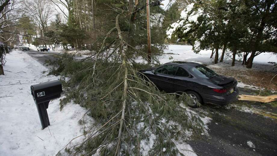 An abandoned car and a tree limb that took out a utility line block a road Thursday in the aftermath of the storm the day before in Media, Pa., a suburb of Philadelphia. PECO, the biggest electric utility in the Philadelphia area, had 395,000 power outages. Photo: Matt Rourke / Associated Press / AP