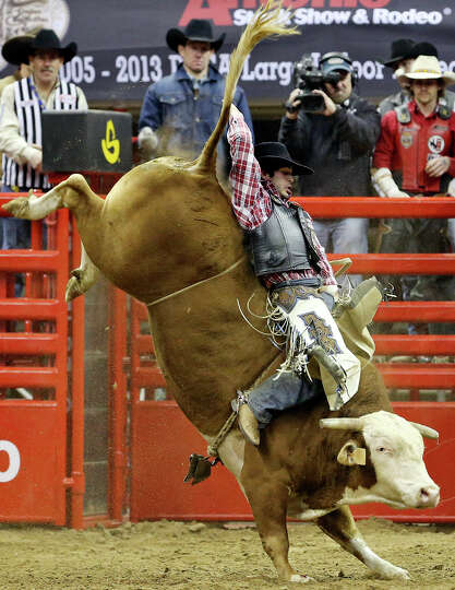 Tim Bingham, of Honeyville, UT, competes in the bull riding event during the San Antonio Stock Show