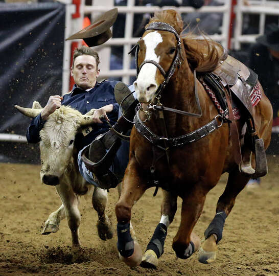 Sean Santucci, of Prineville, OR, competes in the steer wrestling event during the San Antonio Stock