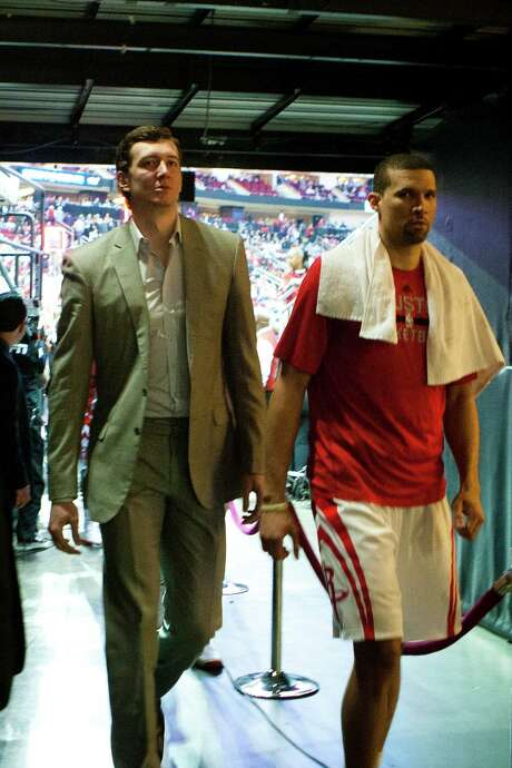 Street clothes have been the work attire of Rockets center Omer Asik, left, over the past two months. Photo: Marie D. De Jesus, Staff / © 2013 Houston Chronicle
