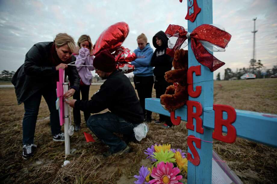 From left, Angie Erhard, Tatum Kemp, James Erhard Ashley Robinson, and Cheyann Coleson bring balloons and memorial items to the site of the fatal car wreck were three people died in Lumberton on Monday. Lumberton Police Chief Danny Sullins said Thursday that Dawn Sterling's, one of the passengers from the wreck, condition is improving. Funeral arrangements for Connely Burns, 20; her unborn child; and Burns' sister, 15-year-old Courtney Sterling are being held by Broussard's in Silsbee.   Photo taken Thursday, February 6, 2014 Guiseppe Barranco/@spotnewsshooter Photo: Guiseppe Barranco, Photo Editor