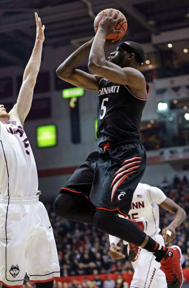 Cincinnati forward Justin Jackson (5) shoots against Connecticut during the first half of an NCAA college basketball game, Thursday, Feb. 6, 2014, in Cincinnati. (AP Photo/Al Behrman) ORG XMIT: OHAB109 Photo: Al Behrman / AP
