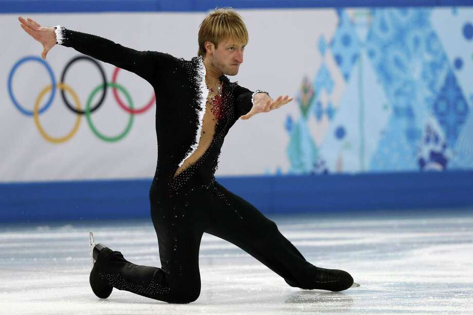 Russian Olympic legend Evgeni Plushenko puts on a show that has the home crowd on its feet during the men's short program Thursday. He placed second. Photo: ADRIAN DENNIS, Staff / AFP
