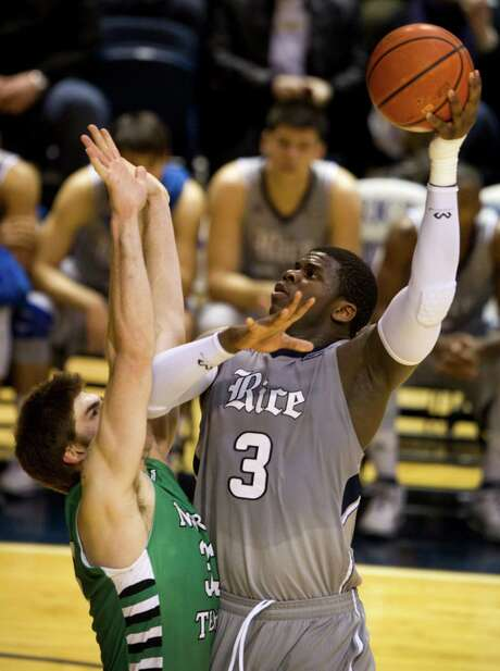 Rice freshman Sean Obi (3) was too much for the likes of North Texas forward Colin Voss to handle, totaling 18 points and 13 rebounds Thursday night. Photo: Brett Coomer, Houston Chronicle / © 2014 Houston Chronicle