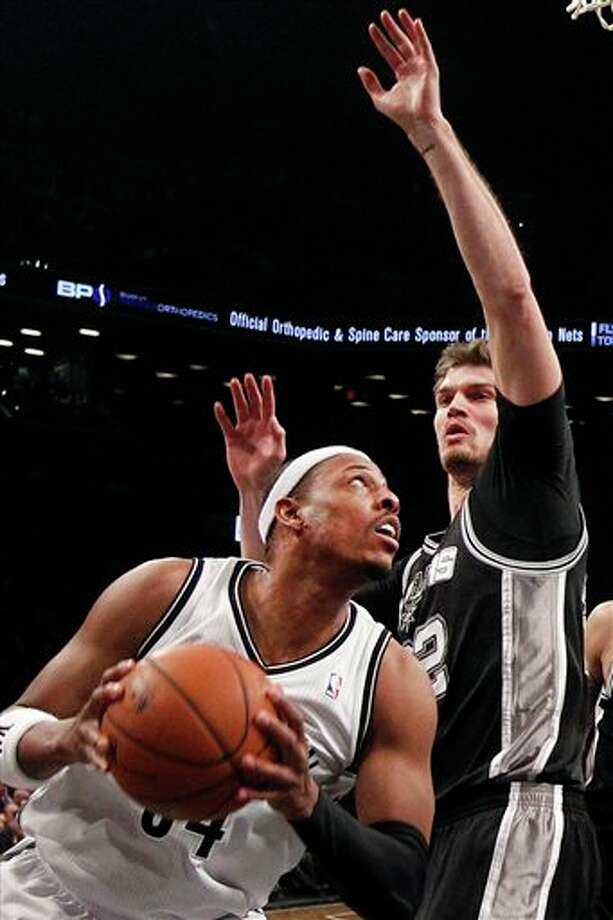 Brooklyn Nets' Paul Pierce, left, looks to shoot against San Antonio Spurs' Tiago Splitter, right, of Brazil, during the first half of an NBA basketball game on Thursday, Feb. 6, 2014, in New York. (AP Photo/Jason DeCrow) Photo: Jason DeCrow, AP / FR103966 AP