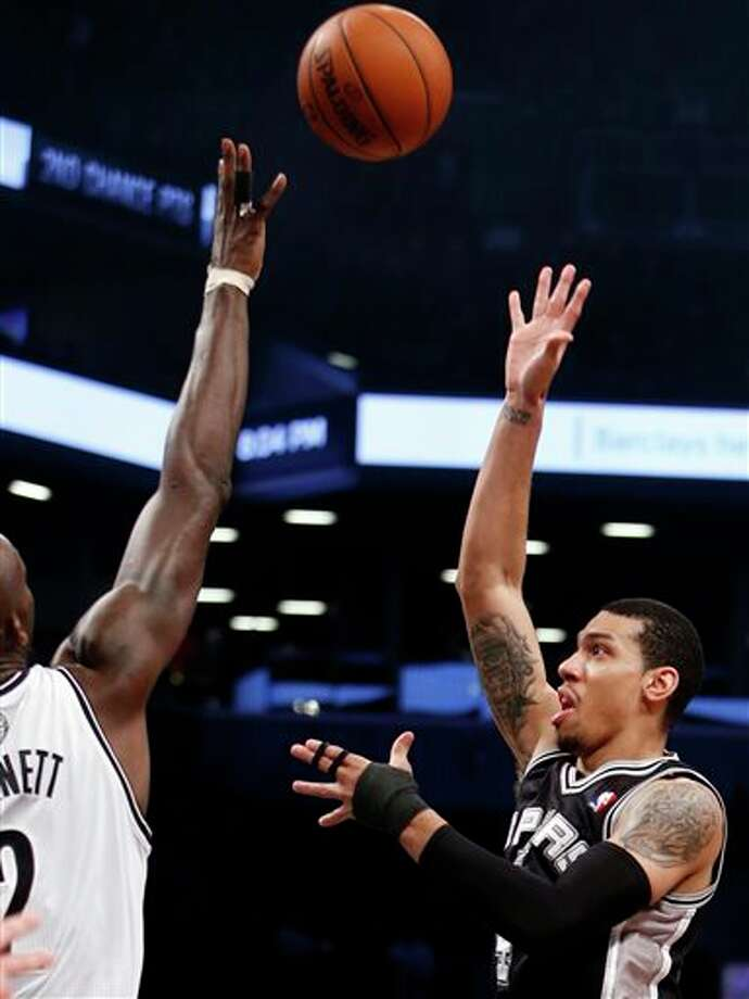 San Antonio Spurs' Danny Green, right, shoots against Brooklyn Nets' Kevin Garnett during the first half of an NBA basketball game on Thursday, Feb. 6, 2014, in New York. (AP Photo/Jason DeCrow) Photo: Jason DeCrow, AP / FR103966 AP