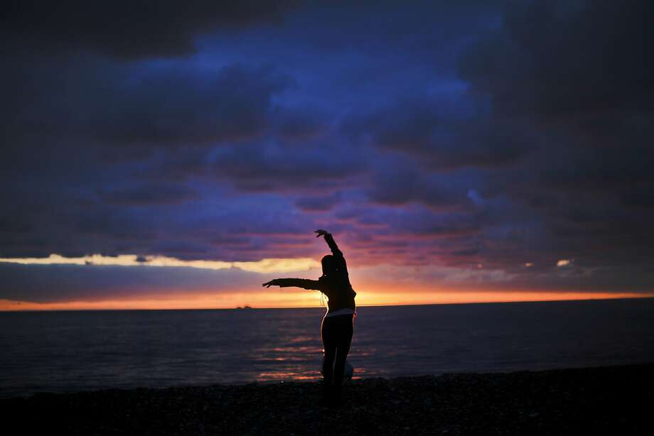 Seaside solo: Elina Suyundikova, a dancer in the Winter Olympics opening ceremony, performs for the sunset along the Black Sea in Sochi. Photo: David Goldman, Associated Press