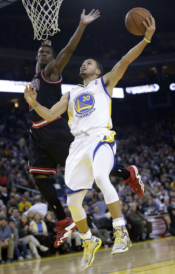 Stephen Curry tries to maneuver around Chicago's Jimmy Butler. Photo: Marcio Jose Sanchez, Associated Press