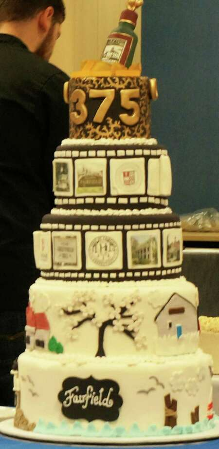 This multi-tiered cake decorated with scenes around town, made by the Pink Cupcake Shack, was the winner Thursday of the  Fairfield 375th Anniversary Bake-Off. Photo: Genevieve Reilly / Fairfield Citizen