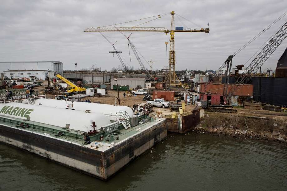 A construction site is seen along the Houston Ship Channel in Houston, Texas, U.S., on Thursday, Jan. 30, 2014. As record oil and gas output floods the country with cheap and abundant energy and brings the U.S. closer to energy independence, the bulk of the fuels get squeezed through Houston, the country's largest export gateway and the core of its biggest refining region. Photo: Scott Dalton, Bloomberg