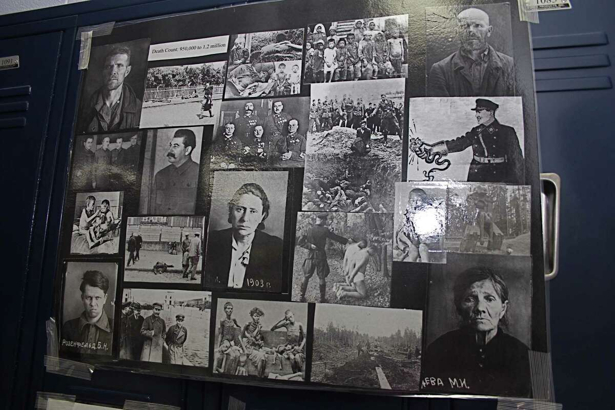 Black-and-white photographs of Holocaust victims were displayed.