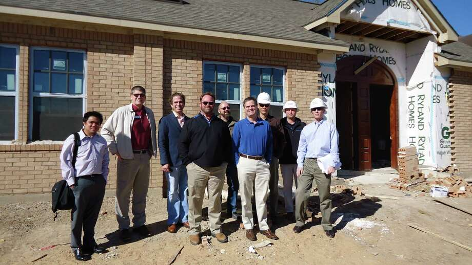 From left are: Rey Lastimosa, Masa Studio Architects; Greg Tomlinson, Builders Post-Tension; Mark Atkins, Masa Studio Architects; Pat Mayhan, Westin Homes; Bert Harvey, HomeAid Houston; David Thompson, PCHAS; Chad Tschetter, Blane Gajdosi and Alan Dossey, Ryland Homes, at the HomeAid Houston PCHAS project that will provide housing for seven single mothers and their children.