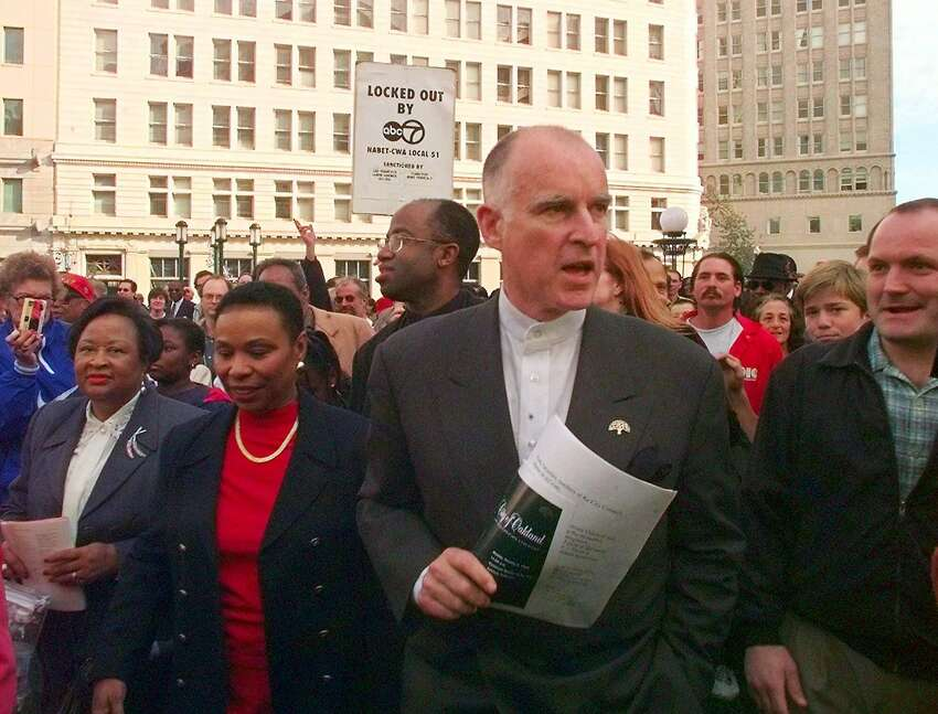 Former California Gov. Jerry Brown greets supporters on the streets of Oakland after being sworn in as the mayor in 1999. When Brown took office he promptly launched an economic push to revitalize downtownOakland.