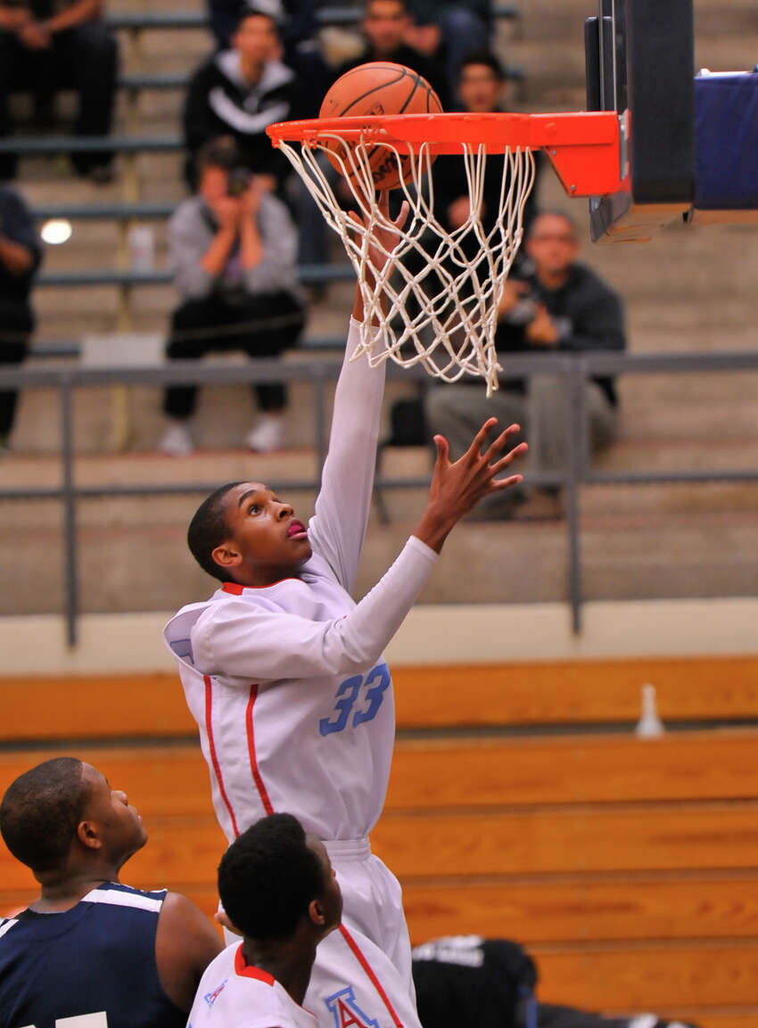 Antonian's Jamel Bradley scores two points in a Feb. 6, 2014 game vs. Central Catholic. The Buttons won 66-55.