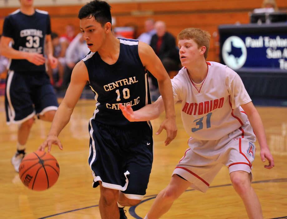 Antonian's  Logan Huff tries to steal the ball from Central Catholic's Jaime Nava during their game Feb. 6, 2014. The Buttons won 66-55. Photo: Robin Jerstad