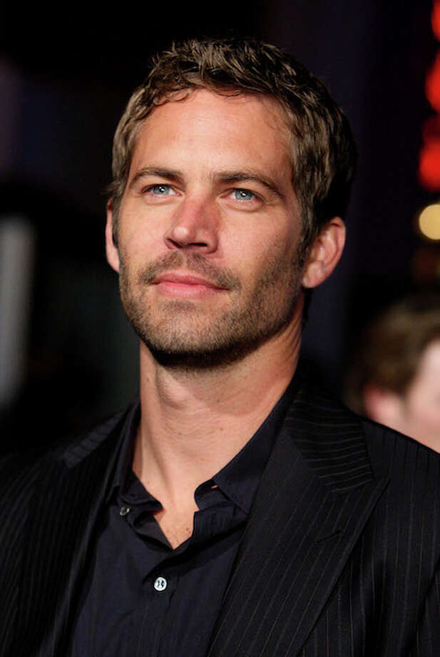 Sunglasses allegedly found at the crash site of the car wreck which killed 'Gone in 60 Seconds' actor Paul Walker just went up on the auction block in March 2014. Photo: Jason Merritt, Getty Images / 2009 Getty Images