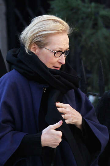 Actress Meryl Streep arrives at the Church of St. Ignatius Loyola for the private funeral of actor P