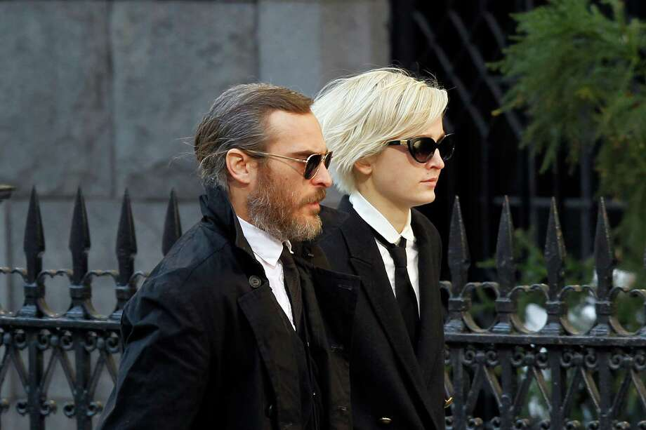 Actor Joaquin Phoenix arrives at the Church of St. Ignatius Loyola for the private funeral of actor Philip Seymour Hoffman Friday, Feb. 7, 2014, in New York. Hoffman, 46, was found dead Sunday of an apparent heroin overdose. Photo: Jason DeCrow, AP / FR103966 AP