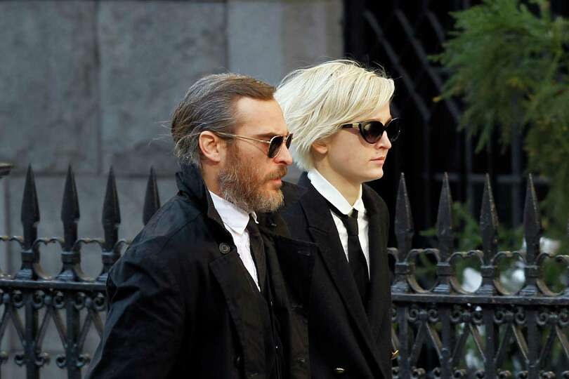 Actor Joaquin Phoenix arrives at the Church of St. Ignatius Loyola for the private funeral of actor