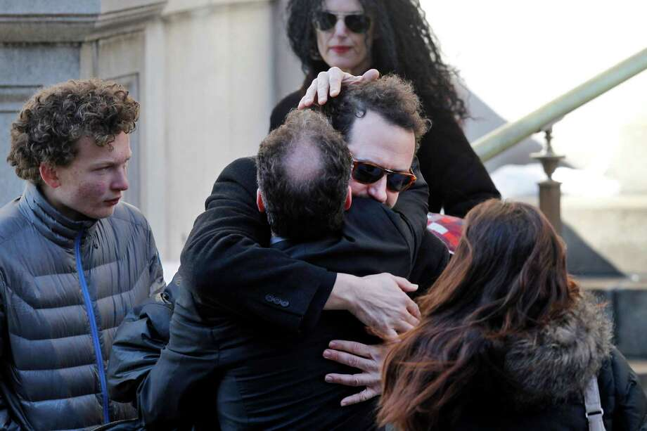 Writer David Bar Katz is embraced as he arrives at the Church of St. Ignatius Loyola for the private funeral of actor Philip Seymour Hoffman Friday, Feb. 7, 2014, in New York. Hoffman, 46, was found dead Sunday of an apparent heroin overdose. Photo: Jason DeCrow, AP / FR103966 AP
