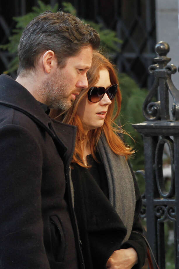 Actress Amy Adams  and her fiance Darren Le Gallo arrive at the Church of St. Ignatius Loyola for the private funeral of actor Philip Seymour Hoffman Friday, Feb. 7, 2014, in New York. Hoffman, 46, was found dead Sunday of an apparent heroin overdose. Photo: Jason DeCrow, AP / FR103966 AP
