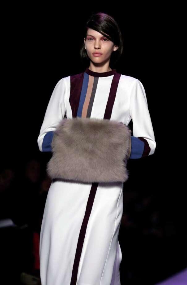 Fur adorns designs in the BCBG Max Azria fall collection. Photo: Richard Drew, STF / AP