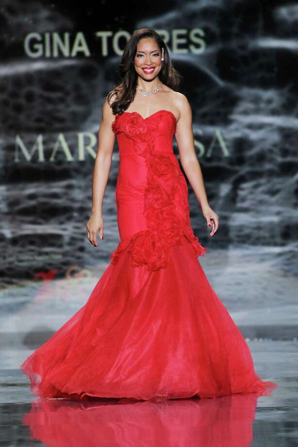 Actress Gina Torres wearing Marchesa as she participates in the Go Red For Women-The Heart Truth Red Dress Collection show during Fashion Week in New York. Photo: Amanda Schwab, Associated Press / STARPIX