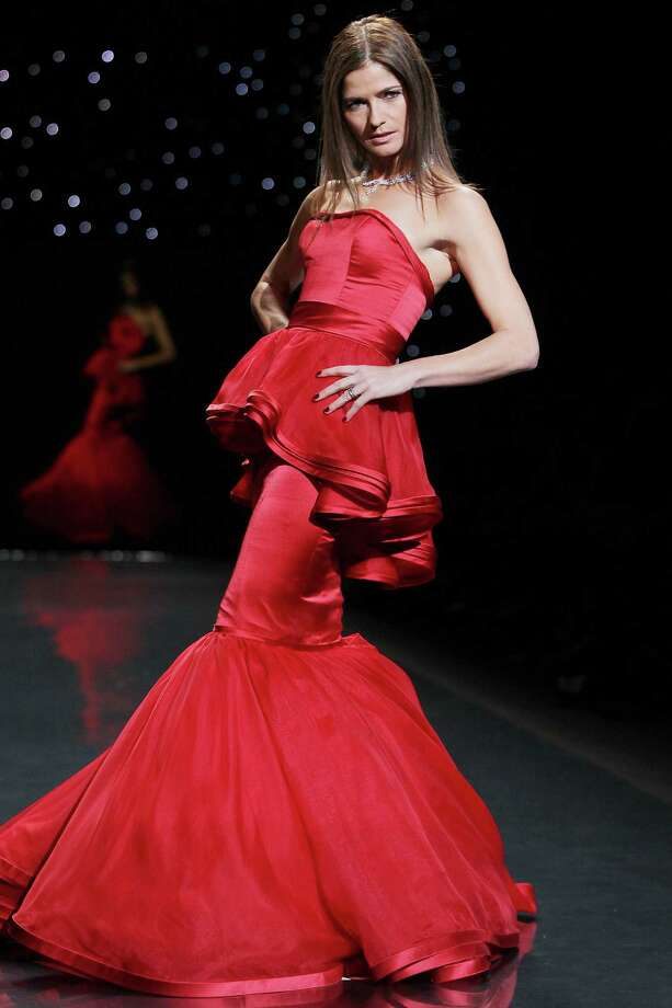 Actress Jill Hennessy wearing Dennis Basso as she participates in the Go Red For Women-The Heart Truth Red Dress Collection show during Fashion Week in New York. Photo: Amanda Schwab, Associated Press / STARPIX