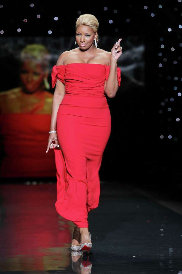 TV personality NeNe Leakes wearing Black Halo as she participates in the Go Red For Women-The Heart Truth Red Dress Collection show during Fashion Week in New York.  Photo: Amanda Schwab, Associated Press / STARPIX