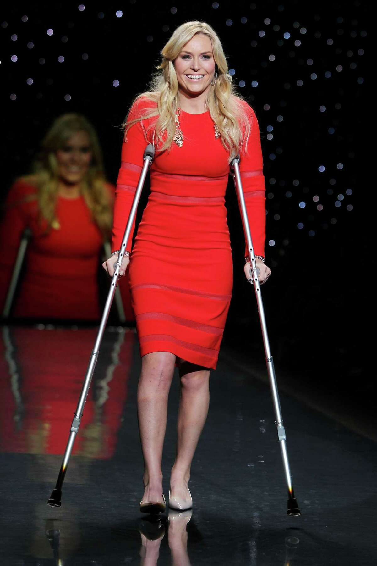 Olympic skier Lindsey Vonn wearing Cynthia Rowley as she participates in the Go Red For Women-The Heart Truth Red Dress Collection show during Fashion Week in New York on Thursday, Feb. 6, 2014.