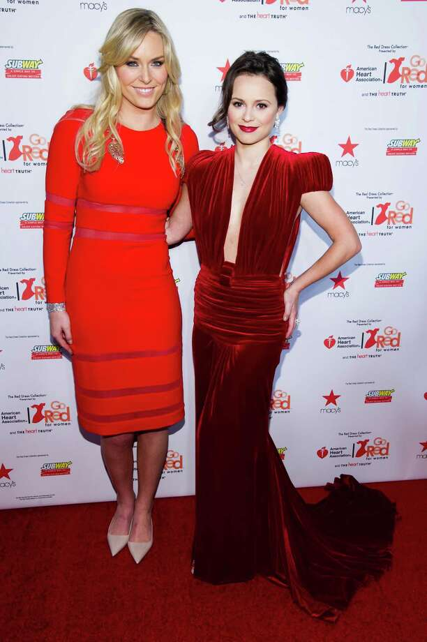 Lindsey Vonn, left, and Sasha Cohen attend the Heart Truth Red Dress Collection fashion show, Photo: Charles Sykes, Associated Press / AP2014