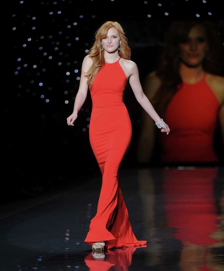 Bella Thorne models an outfit from the 2014 Red Dress Collection on Thursday. Photo: Brad Barket, Associated Press / AP2014
