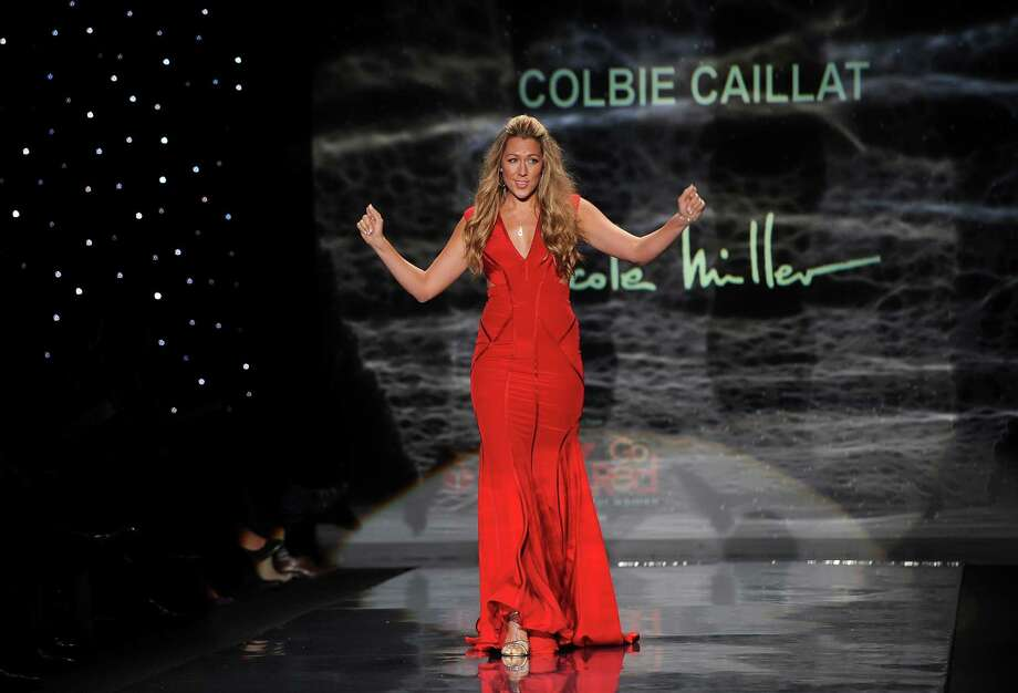 Singer Colbie Caillet walks the runway. Photo: Brad Barket, Associated Press / AP2014