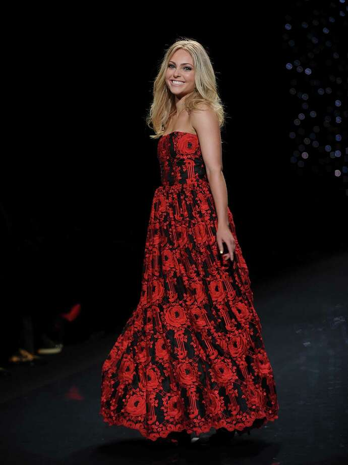 Actress Anna Sophia Robb models an outfit from the 2014 Red Dress Collection on Thursday. Photo: Brad Barket, Associated Press / AP2014