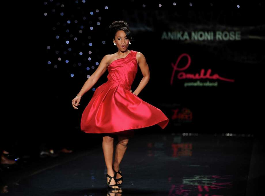 Actress Anika Noni Rose models an outfit from the 2014 Red Dress Collection on Thursday. Photo: Brad Barket, Associated Press / AP2014