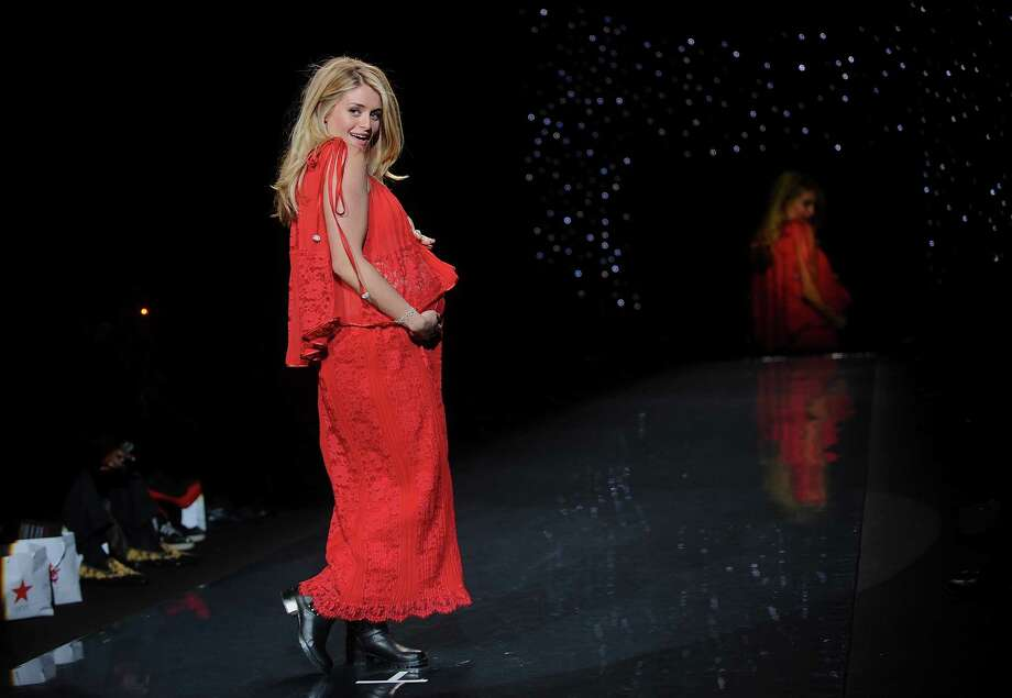 TV host Daphne Nur Oz models an outfit from the 2014 Red Dress Collection on Thursday. Photo: Brad Barket, Associated Press / AP2014