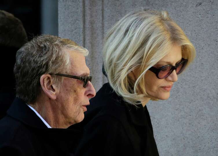 Director Mike Nichols, left, and Diane Sawyer arrive for the funeral of actor Philip Seymour Hoffman