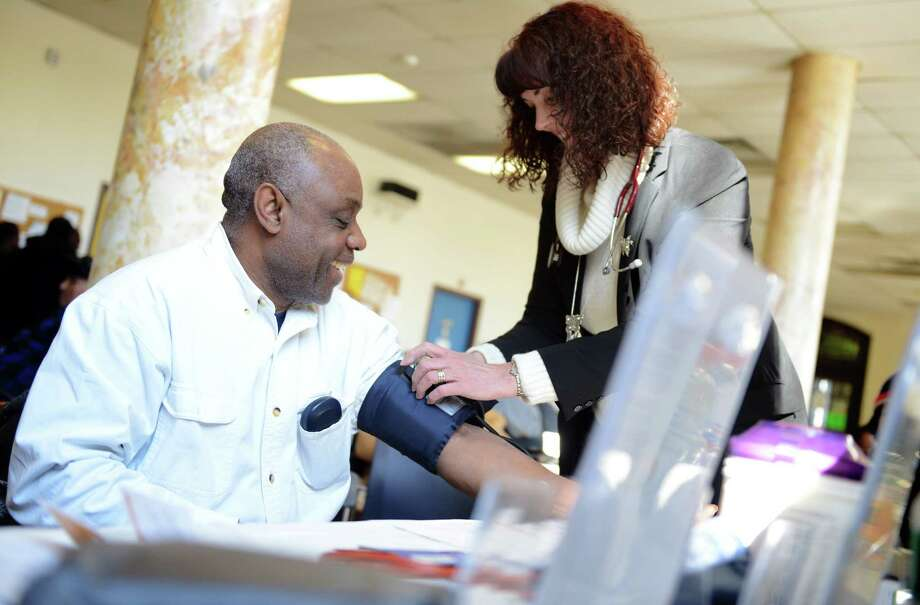 TALK:While you're speaking with your doctor, be sure you know whether your blood pressure and cholesterol are healthy. (Dr. Haroon Rashid, assistant professor at Baylor College of Medicine and Kelsey-Seybold Cardiology) Photo: Autumn Driscoll / Connecticut Post
