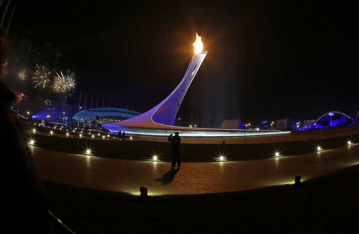 Fireworks are seen after the Olympic Cauldron is lit during the opening ceremony of the 2014 Winter Olympics in Sochi, Russia, Friday, Feb. 7, 2014. (AP Photo/Darron Cummings)