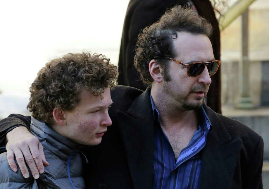 David Bar Katz, right, a friend of actor Philip Seymour Hoffman, arrives for the actor's funeral at the Church of St. Ignatius Loyola, Friday, Feb. 7, 2014 in New York. Hoffman, 46, was found dead Sunday of an apparent heroin overdose.  Photo: Mark Lennihan, Associated Press / AP