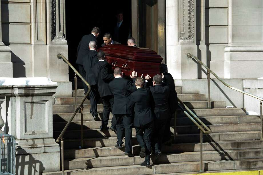 Pallbearers carry Philip Seymour Hoffman's casket into St. Ignatius Of Loyola church during the funeral service for actor Philip Seymour Hoffman at St. Ignatius Of Loyola on February 7, 2014 in New York City. Hoffman died of an alleged drug overdose on February 1, 2014. Photo: D Dipasupil, Getty Images / 2014 Getty Images