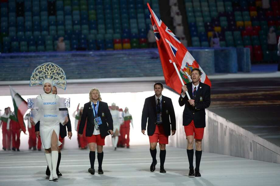 Bermuda's flag bearer, cross-country skier Tucker Murphy leads his national delegation during the Opening Ceremony of the Sochi Winter Olympics at the Fisht Olympic Stadium on February 7, 2014 in Sochi.   AFP PHOTO / ANDREJ ISAKOVICANDREJ ISAKOVIC/AFP/Getty Images Photo: AFP/Getty Images
