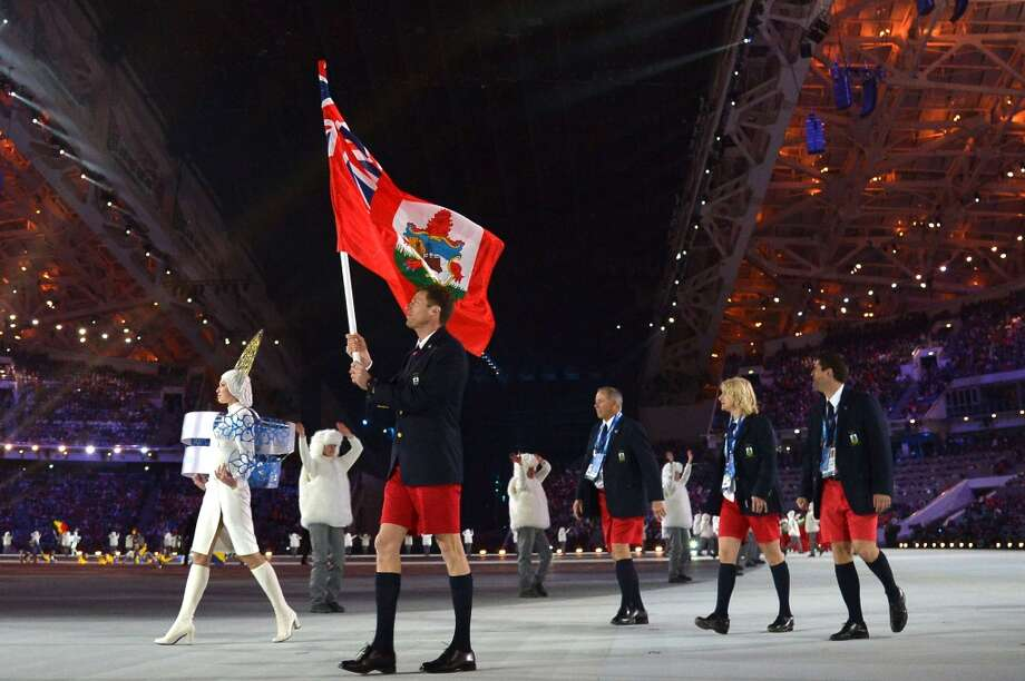 Bermuda's flag bearer, cross-country skier Tucker Murphy leads his national delegation during the Opening Ceremony of the Sochi Winter Olympics at the Fisht Olympic Stadium on February 7, 2014 in Sochi.  AFP PHOTO / ALBERTO PIZZOLIALBERTO PIZZOLI/AFP/Getty Images Photo: AFP/Getty Images