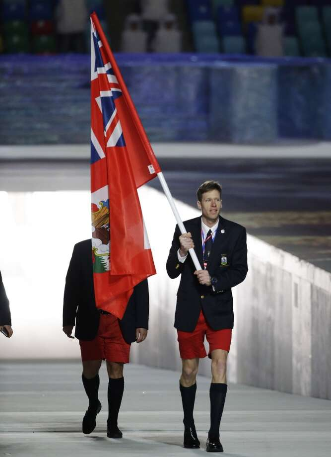 Tucker Murphy of Bermuda carries the national flag as he leads the team during the opening ceremony of the 2014 Winter Olympics in Sochi, Russia, Friday, Feb. 7, 2014. (AP Photo/Mark Humphrey) Photo: Associated Press